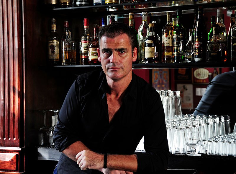 Polo Magazine photo from Alex Webbe of bar tender in black shirt